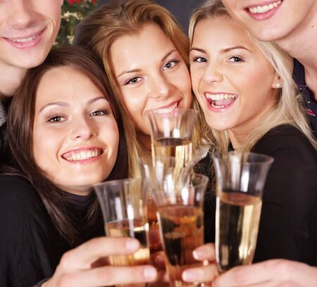 Group young people drink champagne at nightclub. Stock Photo - 8227261