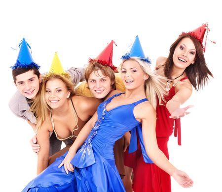 Grupo de jóvenes en parte sombrero celebración de globo. Aislado.  Foto de archivo