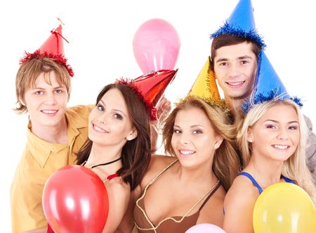 Group of young people in party hat holding balloon. Isolated. photo