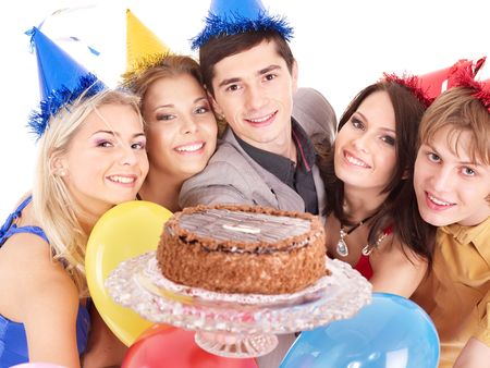 Group people in party hat holding cake. Isolated. photo