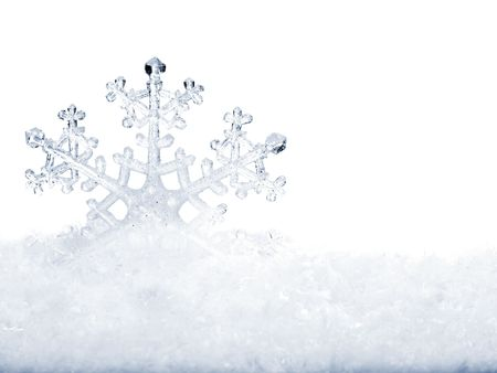 Snowflake in white snow. Isolated. photo