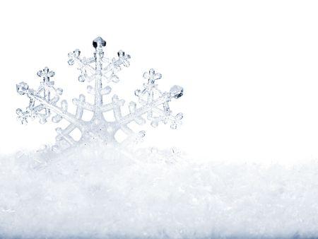 flake: Snowflake in white snow. Isolated.