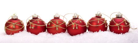 tinsel: Group of christmas ball in snow. Isolated.