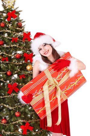 Girl in santa hat holding gift box near christmas tree.  Isolated. Stock Photo - 8405152