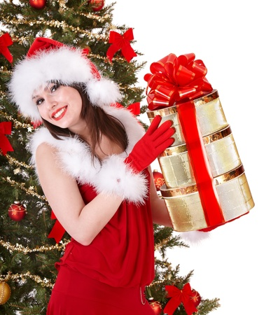 Girl in santa hat holding stack gift box near christmas tree.  Isolated. Stock Photo - 8405116