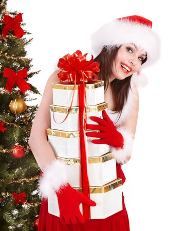 Girl in santa hat holding stack gift box near christmas tree.  Isolated. Stock Photo - 8405082