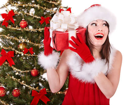 Christmas girl in santa hat holding  gift box.. Isolated. Stock Photo - 8405117