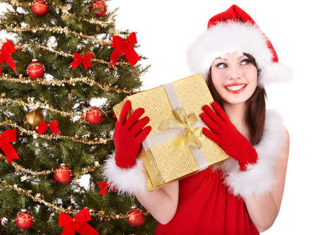 Christmas girl in santa hat holding  gift box.. Isolated. Stock Photo - 8405143