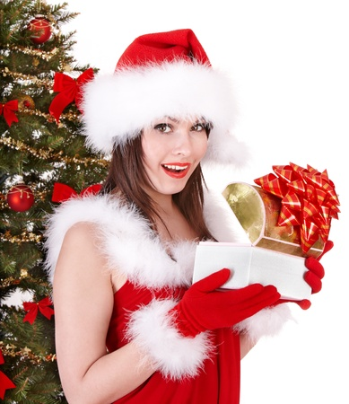 Christmas girl in santa hat holding  gift box.. Isolated. Stock Photo - 8405094