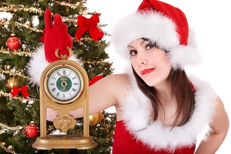 Christmas girl in santa hat holding clock.  Isolated. photo