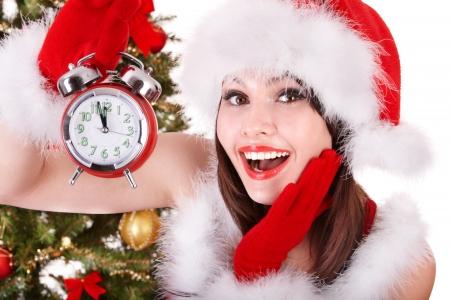 산타 모자: 산타 모자를 들고 스택 선물 상자에 크리스마스 소녀. 입니다. 스톡 사진