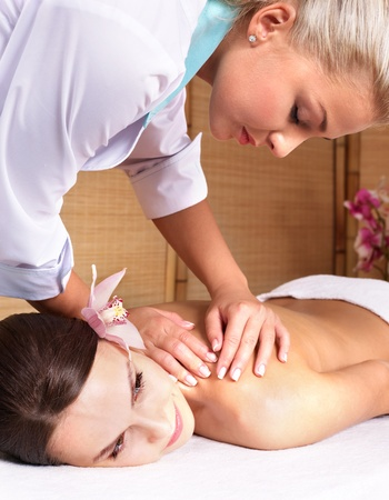 Young beautiful woman on massage table in beauty spa. Series. Stock Photo - 8405168
