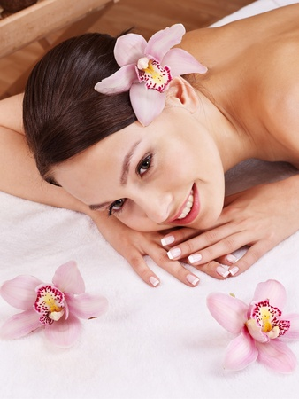 aromatherapy oils: Young beautiful woman on massage table in beauty spa. Series.