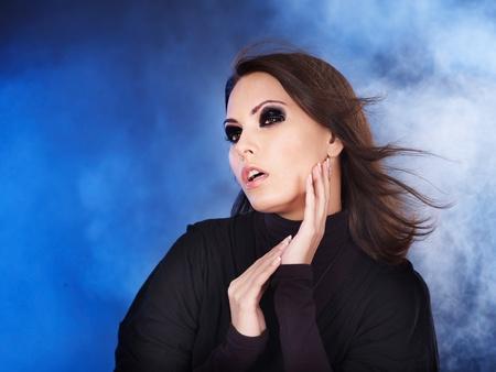 smoky eyes: Fashion studio shot of young woman with smoky eyes .