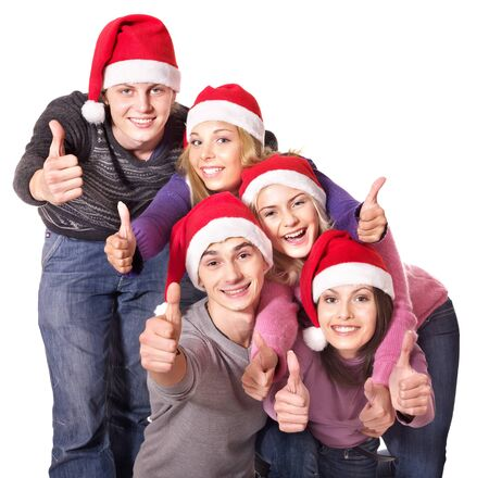 Group young people in santa hat show thumbs up. Isolated. photo