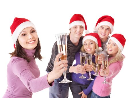 Group young people in santa hat drinking champagne. Isolated. Stock Photo - 8405097