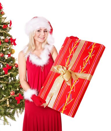 Girl in santa hat holding  gift box by christmas tree.. Isolated. Stock Photo - 8405148