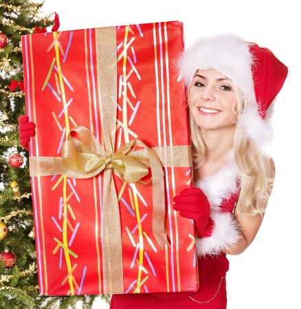 Girl in santa hat holding  gift box by christmas tree.. Isolated. Stock Photo - 8405196