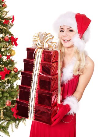 Girl in santa hat holding stack  gift box by christmas tree.. Isolated. Stock Photo - 8405164