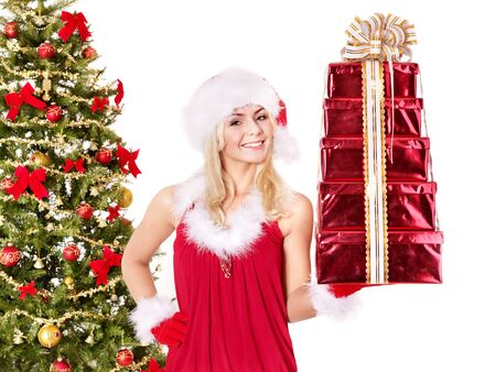 Girl in santa hat holding stack  gift box by christmas tree.. Isolated. Stock Photo - 8405179