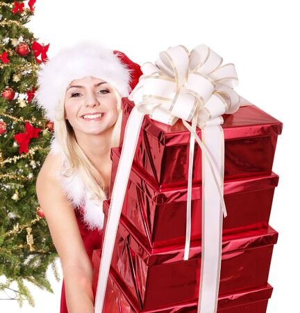 Girl in santa hat holding stack  gift box by christmas tree.. Isolated. Stock Photo - 8405120
