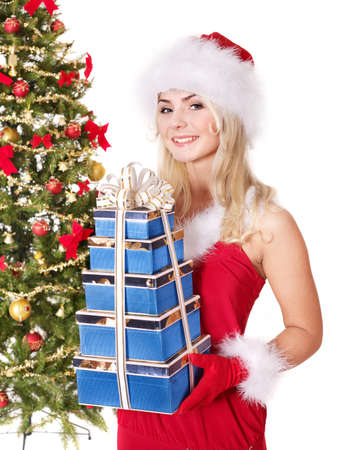 Girl in santa hat holding stack  gift box by christmas tree.. Isolated. Stock Photo - 8405194