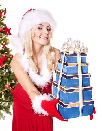 Girl in santa hat holding stack  gift box by christmas tree.. Isolated. Stock Photo - 8405155