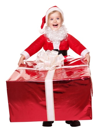 Little girl in santa hat  holding  big  red gift box. Isolated. photo