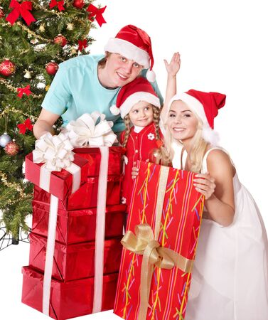 Happy family in santa hat holding gift box.  Isolated. photo