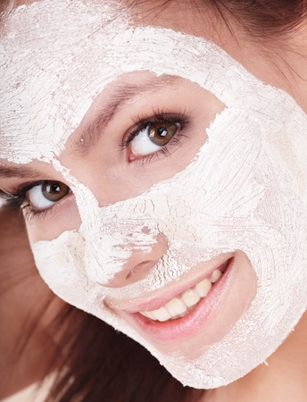 Young womanl with clay facial mask. photo
