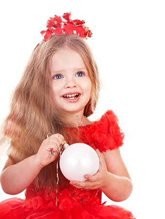 Little girl in red santa hat holding christmas ball. Isolated. photo