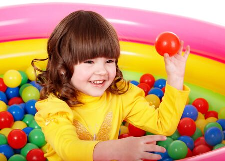 Happy child in group colourful ball. photo