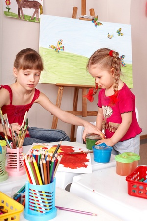 Children drawing colour pencil in play room. photo