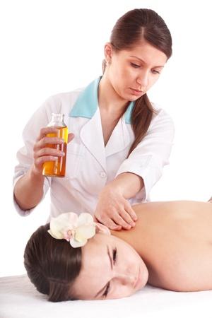 Beautiful white girl having thai massage. photo