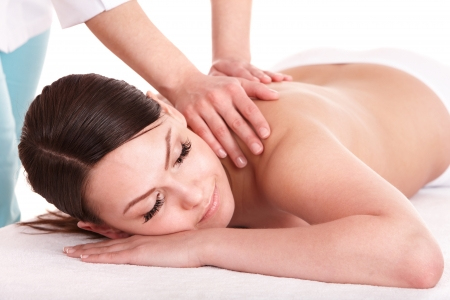 Massage therapy: Girl having back massage. Isolated.
