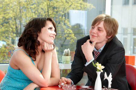 Couple on  date in restaurant. Flirting. photo