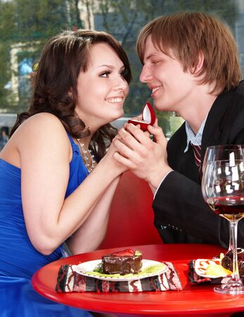 Man propose marriage to girl in restaurant. Stock Photo - 8332635