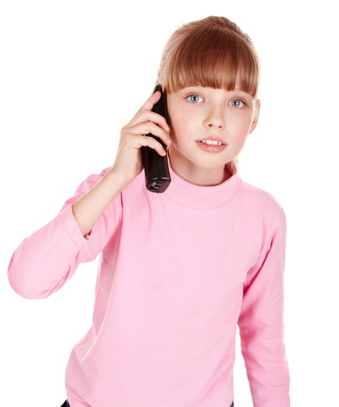 Little girl talking by telephone. Isolated. photo