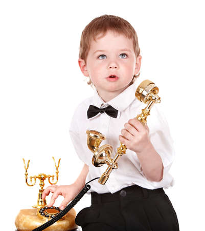 Boy in business suit with telephone. Isolated. photo