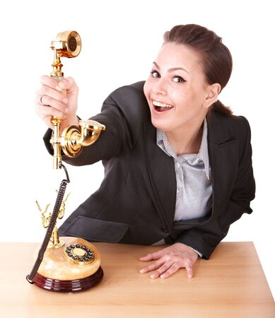 Happy businesswoman with golden phone. Isolated. Stock Photo - 8332709