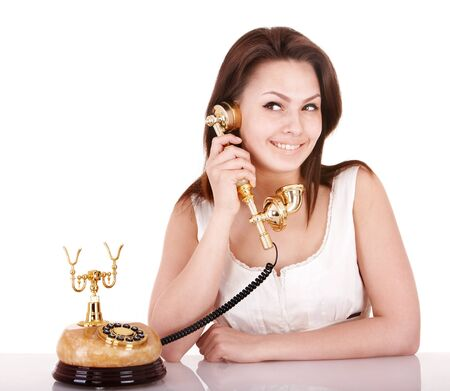 Young beautiful woman talking by phone. Isolated. Stock Photo - 8332626