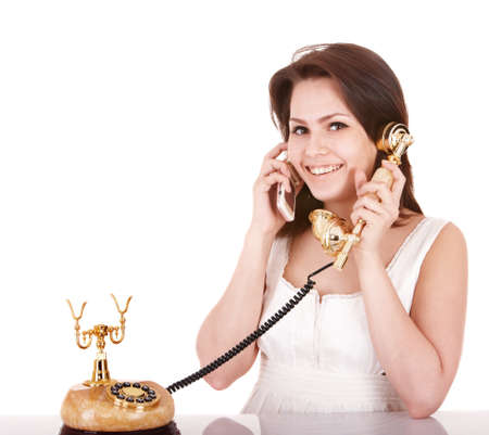 Young beautiful woman talking by phone. Isolated. Stock Photo - 8332604