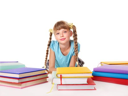 Child with pile of books  lying on floor. Isolated. Stock Photo - 8332704