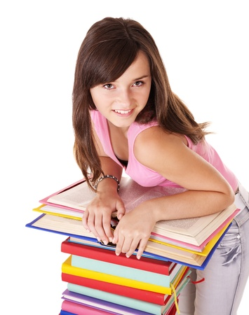 Girl School: Girl with pile colored book . Isolated. Stock Photo