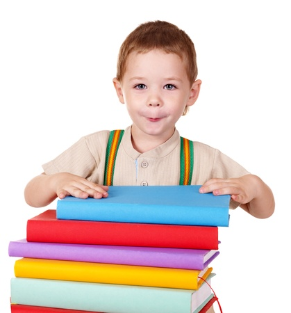 Little boy reading pile of books. photo