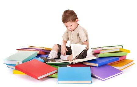 boy book: Little boy reading pile of books.