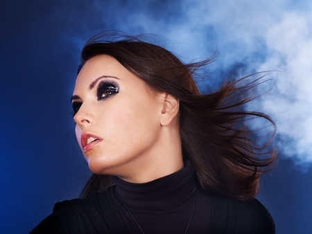 Fashion studio shot of young woman with smoky eyes . photo