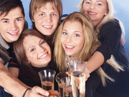 Group young people drinking champagne. photo