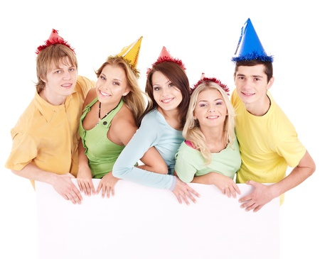 Group of happy people in party hat holding banner. Isolated. photo
