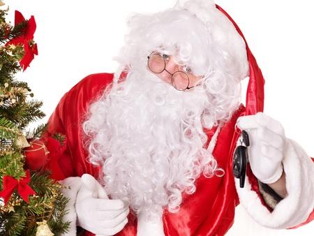 car lock: Santa Claus giving auto keys by christmas tree. Isolated.